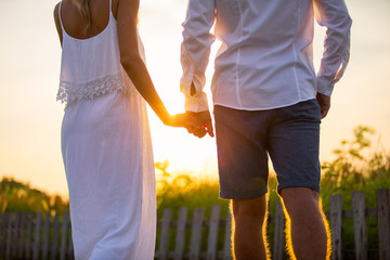 Couple walking outside at sunset