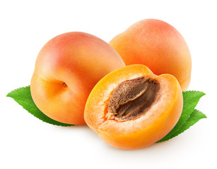 Two whole apricot fruit and half with leaves isolated on white background with clipping path