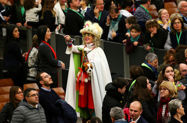 A woman takes a selfie during a special audience by Pope Francis for a delegation of donors of the Christmas tree and the nativity scene set up in Saint Peter's square at the Vatican
