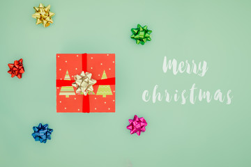 Red gift box with GREEN ribbon. Christmas present card