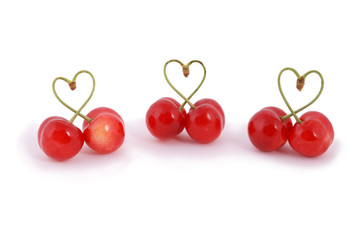 Pair of sweet cherry fruits with heart shaped stem