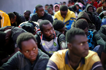 Migrants arrive at a naval base after they were rescued by Libyan Navy, in Tripoli