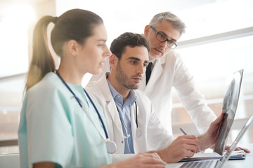 Medical team checking Xray results