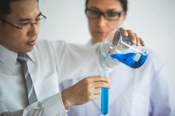 The medicals or scientific laboratory researcher performs tests with liquid in lab