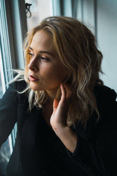 Romantic woman posing on windowsill