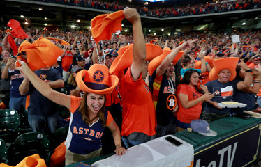 Astros fans watch and cheer as their team plays in Los Angeles during a World Series Game Seven watch party in Houston