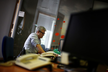 Reuters reporter Andrei Khalip works at the Reuters office in Lisbon