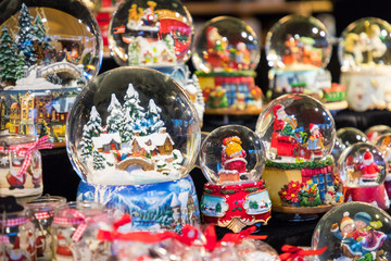 Various Christmas snow globes at a Christmas market in Berlin, Germany.