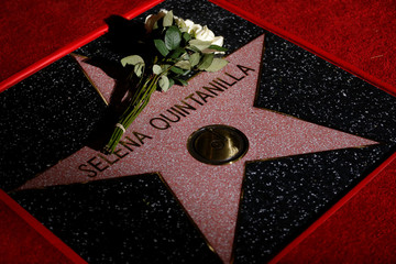 Flowers are seen on the star of late singer Selena Quintanilla-Perez after it was unveiled on the Hollywood Walk of Fame in Los Angeles