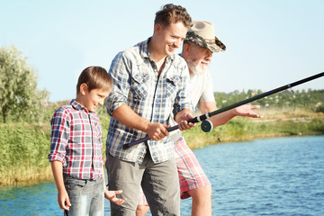 Family fishing on pond together