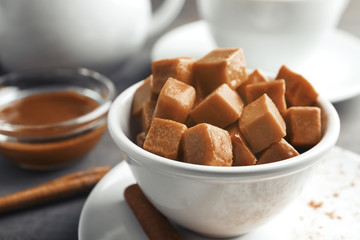 Bowl with sweet caramel candies, closeup