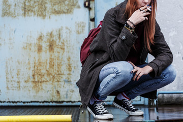 Riotous teenager smoking cigarette