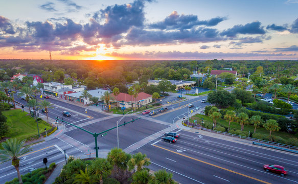 An overhead view of an intersection at sunset