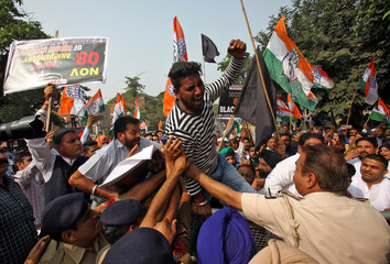 A demonstrator reacts as he is stopped by police during a protest, organised by India's main opposition Congress party, to mark a year since demonetisation was implemented by Prime Minister Narendra Modi, in Chandigarh