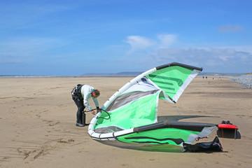 kitesurfer inflating his kite