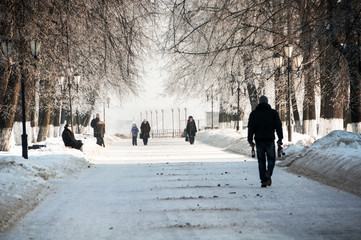People walking by the park during the cold winter day in Yaroslavl, Russia