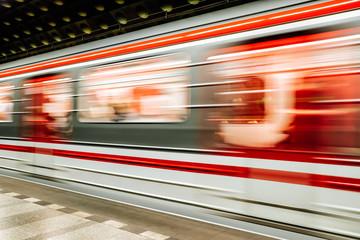 Fast blurry train in subway