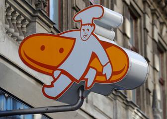 "The logo of Austrian bakery chain ""Der Mann"" is seen at a branch in Vienna"