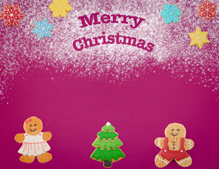 Christmas cookies of different shapes and sizes with a festive decor on a magenta background. Holiday Poster concept.  Empty place for a postural inscription