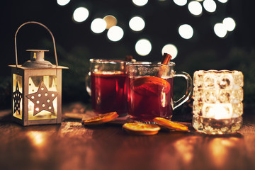 Two glasses of hot christmas drink with spices
