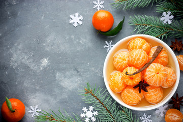 Tangerines in spicy sugar syrup, sweet Christmas treats, winter seasonal background