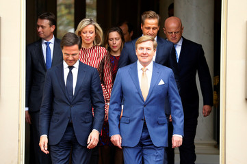 King Willem-Alexander of the Netherlands arrives with Prime Minister Mart Rutte and the new members of the Dutch Government for the Family portrait at the Noordeinde Palace in The Hague
