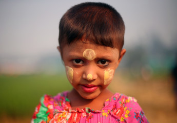 Amirah, 5, a Rohingya refugee girl wearing makeup poses for a photograph in Balukhali refugee camp near Cox's Bazar