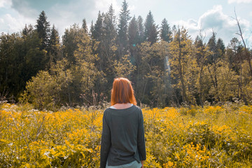 Woman standing in field, looking at view, rear view, Ural, Chelyabinsk, Russia, Europe