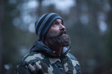 Man in woolly hat in forest