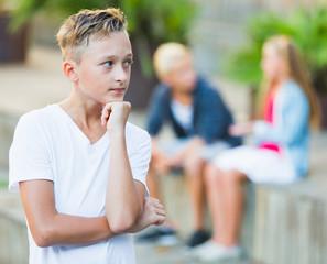 Sad boy having problems with friends
