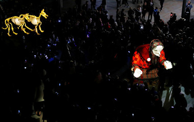 Crowds line the streets during a Halloween lantern carnival in Liverpool
