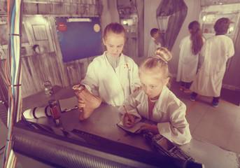 five kids solve task in the bunker quest room