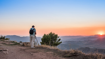 Photographer taking pictures at sunset landscape in Siurana de Prades, Tarragona, Spain. Copy space for text.
