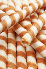 Ice cream wafer sticks as background. Wafer biscuit swirled stick texture. Wafers pattern. Food photos.