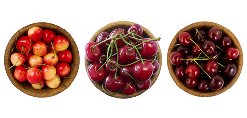 Set of cherries. Sweet cherry mix. Sweet cherry berries in wooden bowl isolated on white background cutout. Cherry fruit with copy space for text. Cherry on white. Red, yellow and burgundy cherry