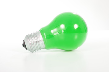Green light bulb. Classic shape bulb with green color..
