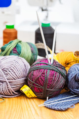 hand knitting and sewing materials on table