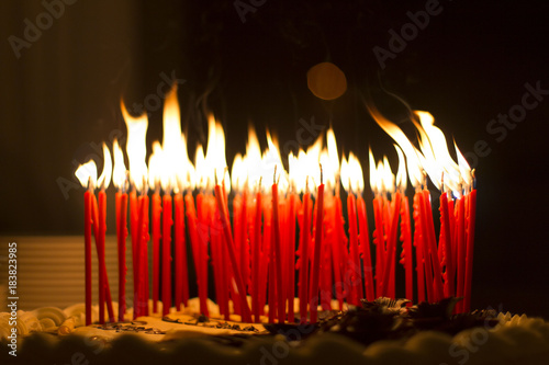 Birthday Cake With Red Candles Burning