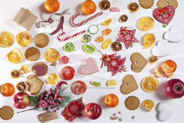 Christmas backdrop with sweets, candies, toys, apples and tangerines. Copy space