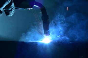 Industrial steel welder in factory