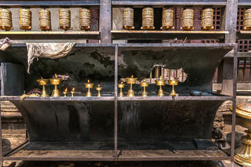 old traditional temple with candles and cylinders sacred for the hindu sacraments. patan. kathmandu. nepal