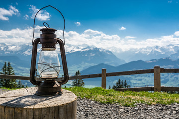 Old rusty lantern near camping place on Wildspitz peak in Switzerland
