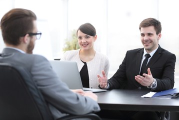 employees communicate with the customer in the office