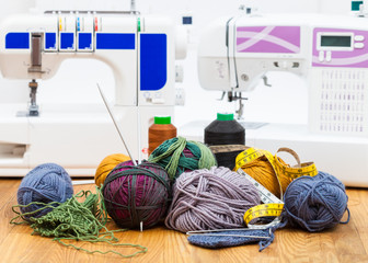 wool knitting yarn on table and sewing machines