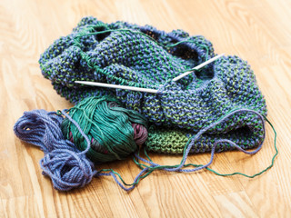 knitting materials on wooden table