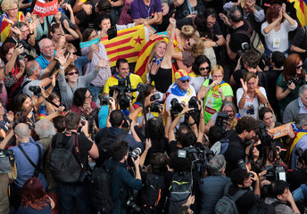 People react as the Catalan regional parliament voted to declare independence from Spain in Barcelona