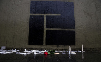 A rose is seen placed in front of the logo of the Instituto Politecnico high school, where the five Argentine citizens who were killed in the truck attack in New York on October 31 went to school, outside its building in Rosario