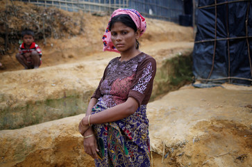 Dilder Begum, 25, a Rohingya refugee who is nine months pregnant, poses for a picture outside her shelter at Kutupalong refugee camp near Cox's Bazar
