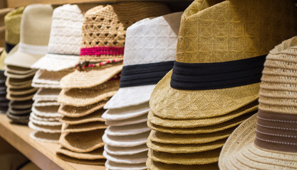 rows of colorful hats in a hat shop