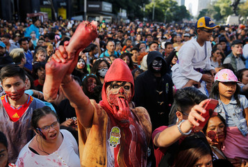 People dressed as zombies participate in an annual Zombie Walk in Mexico City